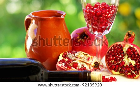 pomegranate and glass of red wine