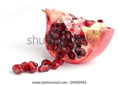 Pomegranate extremely close on white background