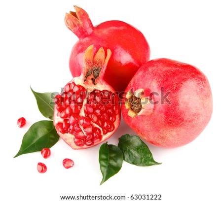 pomegranate fresh fruits with green leaves isolated on white background