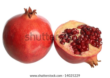 Pomegranate fruit and a half, isolated on white background