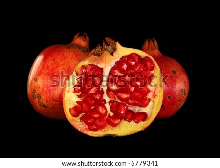 Pomegranate fruit isolated on a over black background