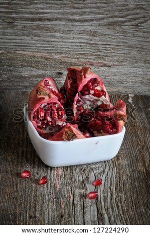 pomegranate fruit on wooden background
