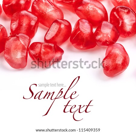 Pomegranate fruit seeds on white background