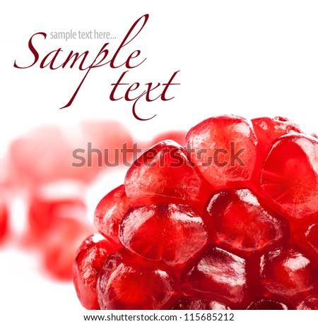 Pomegranate fruit seeds on white background