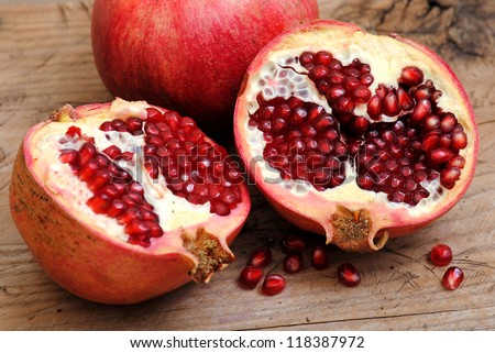 Pomegranate fruits on rustic wood background.Winter fruits.