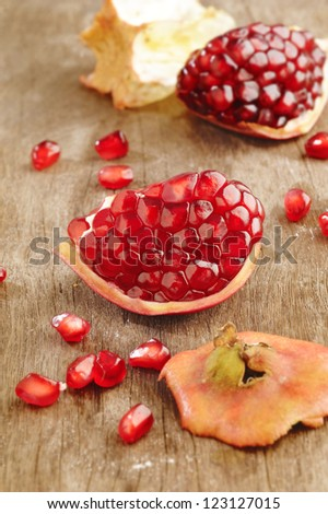 Pomegranate fruits on wooden background