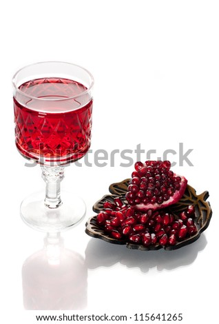 Pomegranate juice and pomegranate seeds on a white background - stock photo