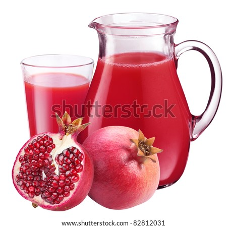 Pomegranate juice in pitcher and pomegranates. Isolated on white background