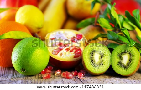 Pomegranate, kiwi, orange and variety of fruits