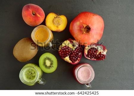 Pomegranate, peach and kiwi juice - Shutterstock ID 642425425