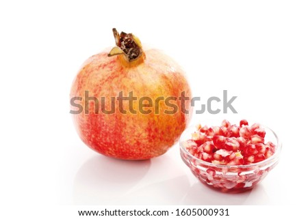 Pomegranate (Punica granatum) with seeds and pulp, arils