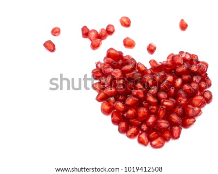 pomegranate seeds isolated on white selective focus.  image of a heart of pomegranate seeds.