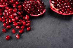 pomegranate seeds  over black background
