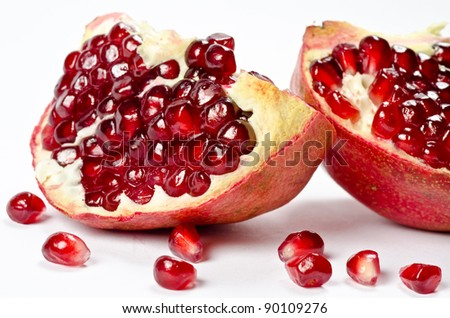 Pomegranate with grains isolated on white