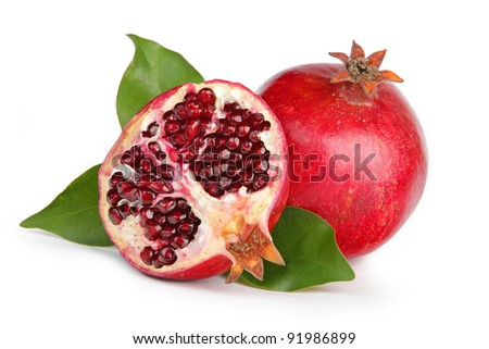 Pomegranate with leaves, isolated on a white background.
