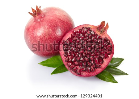 Pomegranate with leaves isolated on white, clipping path included