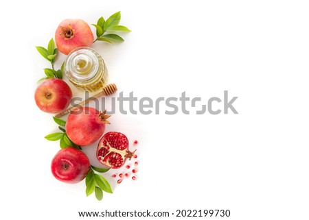 Pomegranates, apples and honey on white background, traditional food of Jewish New Year - Rosh Hashanah.Top view. Copy space background Photo stock ©