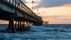 Pompano Beach Pier Broward County Florida at the Beach by sunrise.