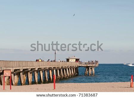 Pompano fishing pier stock photo 71383687 shutterstock for Pompano fishing pier