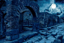 Pompeii at night, Italy. Mystic apocalyptic view of destroyed houses of ancient city in full moon. Spooky dark scene for Halloween theme. Concept of history, mystery, ruins and creepy deserted place.
