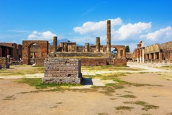 Pompeii forum and Temple of Jupiter (Tempio di Giove). Ruins of Ancient Roman city in Pompei, Province of Naples, Campania, Italy buried under ashes after eruption of Vesuvius. Unesco