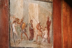 Pompeii, Italy. Ancient Frescoes In Wall Of Old Building.