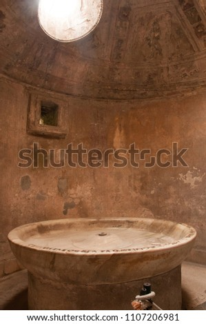 Pompeii, Italy-October 24, 2013:  Steam Baths show evidence of contruction and design in buildings in Pompeii, Italy #1107206981