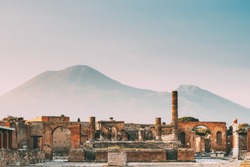 Pompeii, Italy. Temple Of Jupiter Or Capitolium Or Temple Of Capitoline Triad On Background Of Mount Vesuvius.