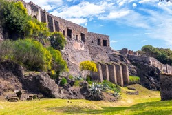 Pompeii near Naples, Italy. Pompeii is an ancient Roman city died from the eruption of Mount Vesuvius. Scenic panorama of Pompeii ruins. Abandoned buildings remains of Pompeii on a sunny summer day.
