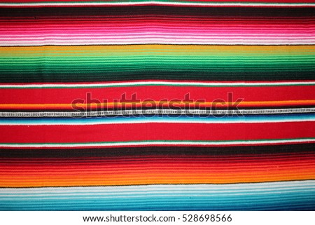 poncho background Cinco de mayo Mexican serape fiesta pattern traditional culture blanket with stripes pattern copy space fabric textile material Mexicano #528698566