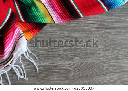 poncho serape background Mexican cinco de mayo fiesta wooden copy space stripe pattern minimalist simple - Shutterstock ID 628813037
