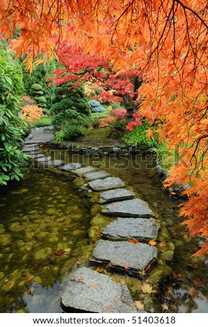 Pond and path of the japanese garden inside the famous historic butchart gardens (built in 1903), vancouver island, british columbia, canada