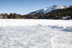 Pond ice rink in the mountains of Colorado