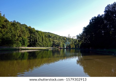 Pond in beautiful nature used for recreational fishing