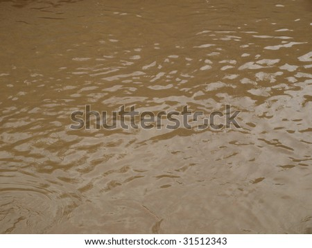 Pond of muddy water following a flood