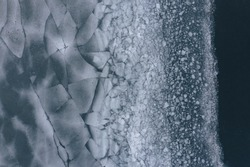 pond on ice, ice, cracked ice, winter lake or pond, aerial shots