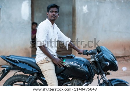 PONDICHERY, PUDUCHERRRY, TAMIL NADU, INDIA - SEPTEMBER CIRCA, 2017. The main transportation way in indian villages, motirbikes, for people products materials business #1148495849