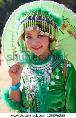 PONGYANG, CHIANGMAI/THAILAND - JANUARY 15: Unidentified traditionally dressed Hmong hill tribe woman in Hmong new year festival on January 15, 2013 in Chiangmai, Thailand.