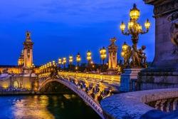 Pont Alexandre III (Alexander the third bridge) over river Seine in Paris, France. Architecture and landmarks of Paris. Postcard of Paris