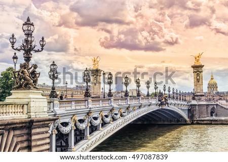 Pont Alexandre III (Alexandre III bridge) in Paris at sunset, France