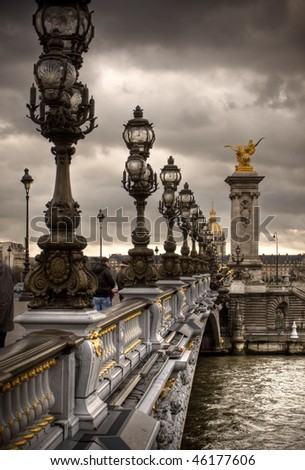 Pont Alexandre III - Bridge in Paris, France.  Gloomy winters day. - stock photo