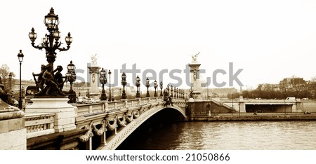 Pont Alexandre III - Bridge in Paris, France.  Movement on cars driving - Gloomy winters day. Copy space, sepia tone