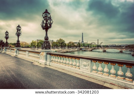 Stock Photo Pont Alexandre III bridge in Paris, France. Seine river and Eiffel Tower. Vintage