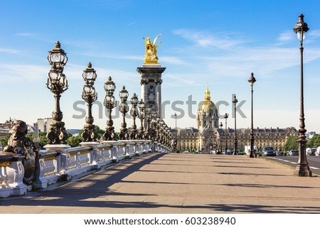 Pont Alexandre III bridge over river Seine and Hotel des Invalides in the background in the sunny summer morning. Bridge decorated with ornate Art Nouveau lamps and sculptures. Stock photo ©
