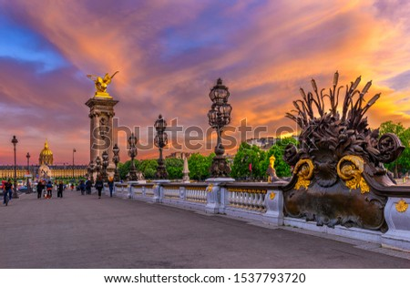 Pont Alexandre III bridge over river Seine and Hotel des Invalides on background at sunset in Paris, France. Architecture and landmarks of Paris. Sunset cityscape of Paris Stock photo ©