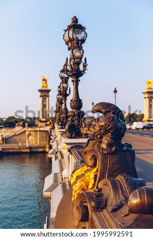 Pont Alexandre III bridge over river Seine in the sunny summer morning. Bridge decorated with ornate Art Nouveau lamps and sculptures. The Alexander III Bridge across Seine river in Paris, France. Stock photo ©