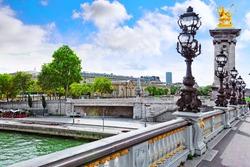 Pont Alexandre III bridge (1896) spanning the river Seine. Decorated with ornate Art Nouveau lamps and sculptures .Paris.