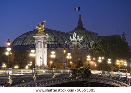 Pont Alexandre III with the Grand Palais in the background at dusk