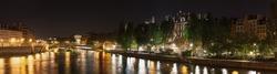 Pont d'Arcole, Hotel de Ville, Quai de l'Hotel de ville, Quai aux Fleurs and Parc des Rives de Seine at night. Paris. France
