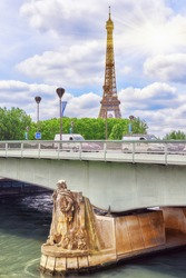 Pont de l'Alma (Alma Bridge in English) is a road bridge in Paris across the Seine and Zouave statue and Eiffel Tower.